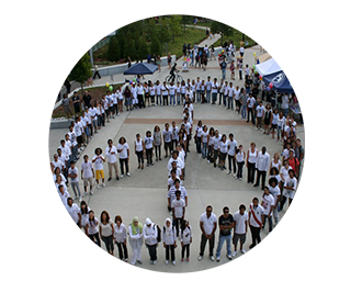 Students standing in a peace sign formation