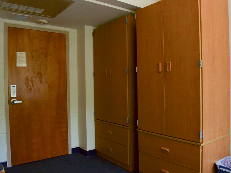 Two armoire closets with two doors and dresser drawer.