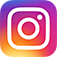 Rainbow colored Instagram icon link with white camera outline inside