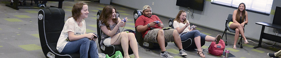 Residents playing video games while laughing and smiling.