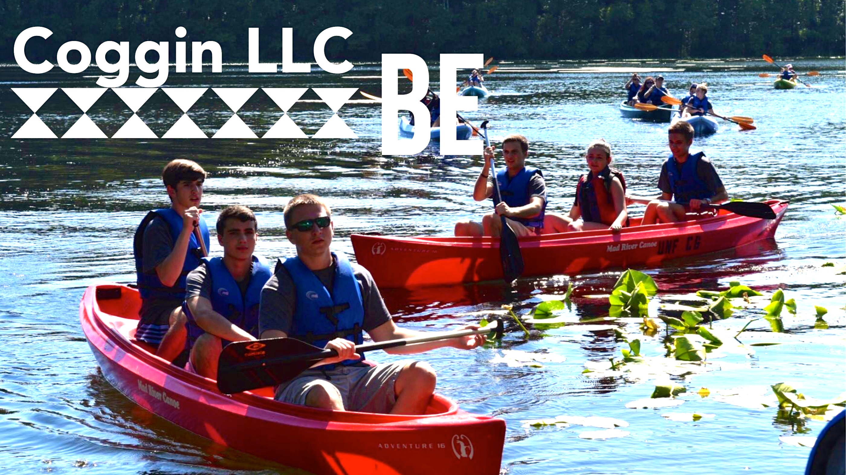 Coggin Living-learning community picture of students building relationship while canoeing on a lake.