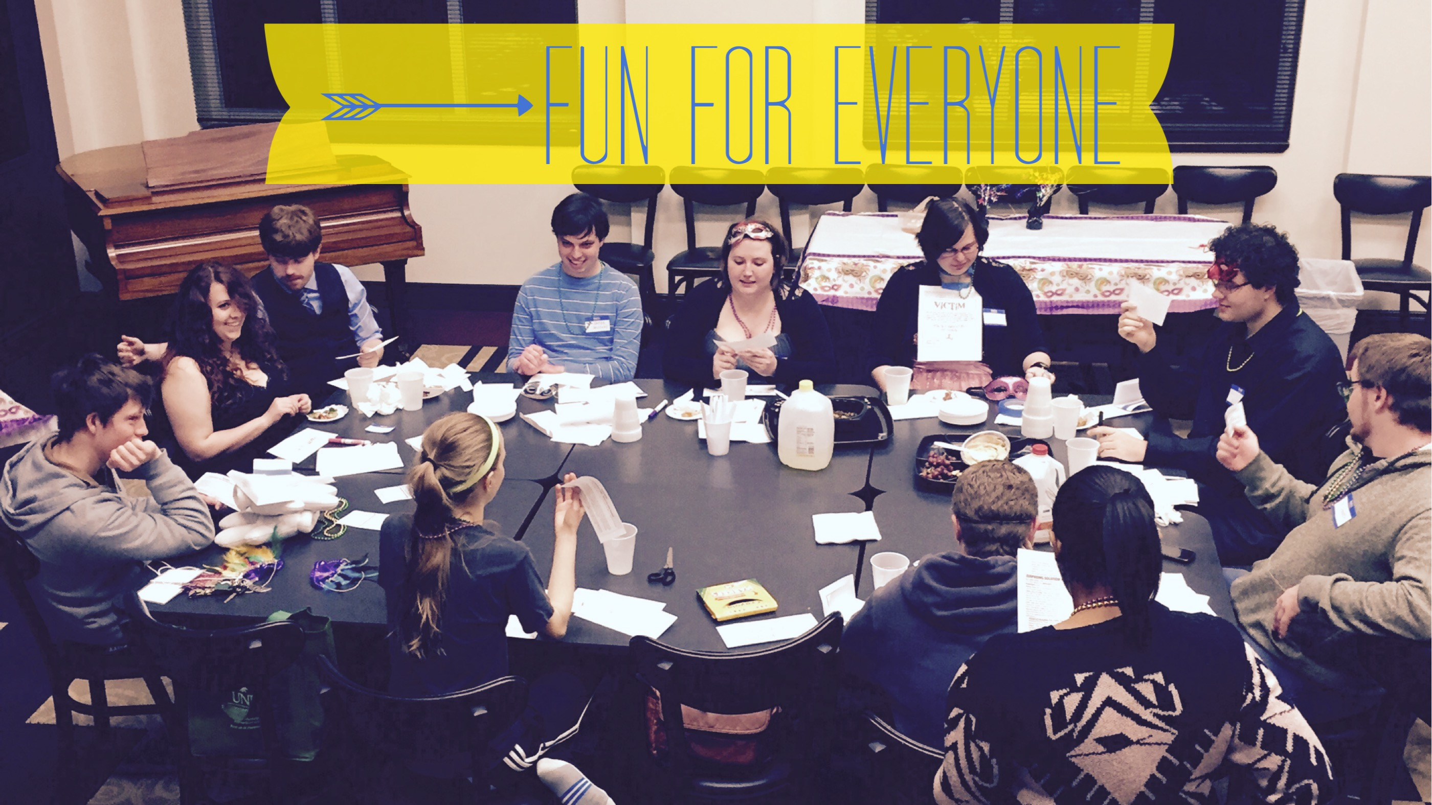 young people sitting at a big table working together and hanging out with the words fun for everyone on top