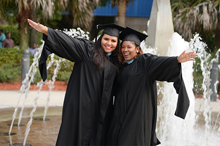 Degree seeking students wearing cap and gown