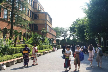 students walking in front of sophia university main building