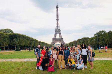 group of students in front of the Eiffel tower