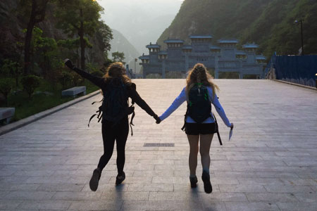 two students in the mountains in China