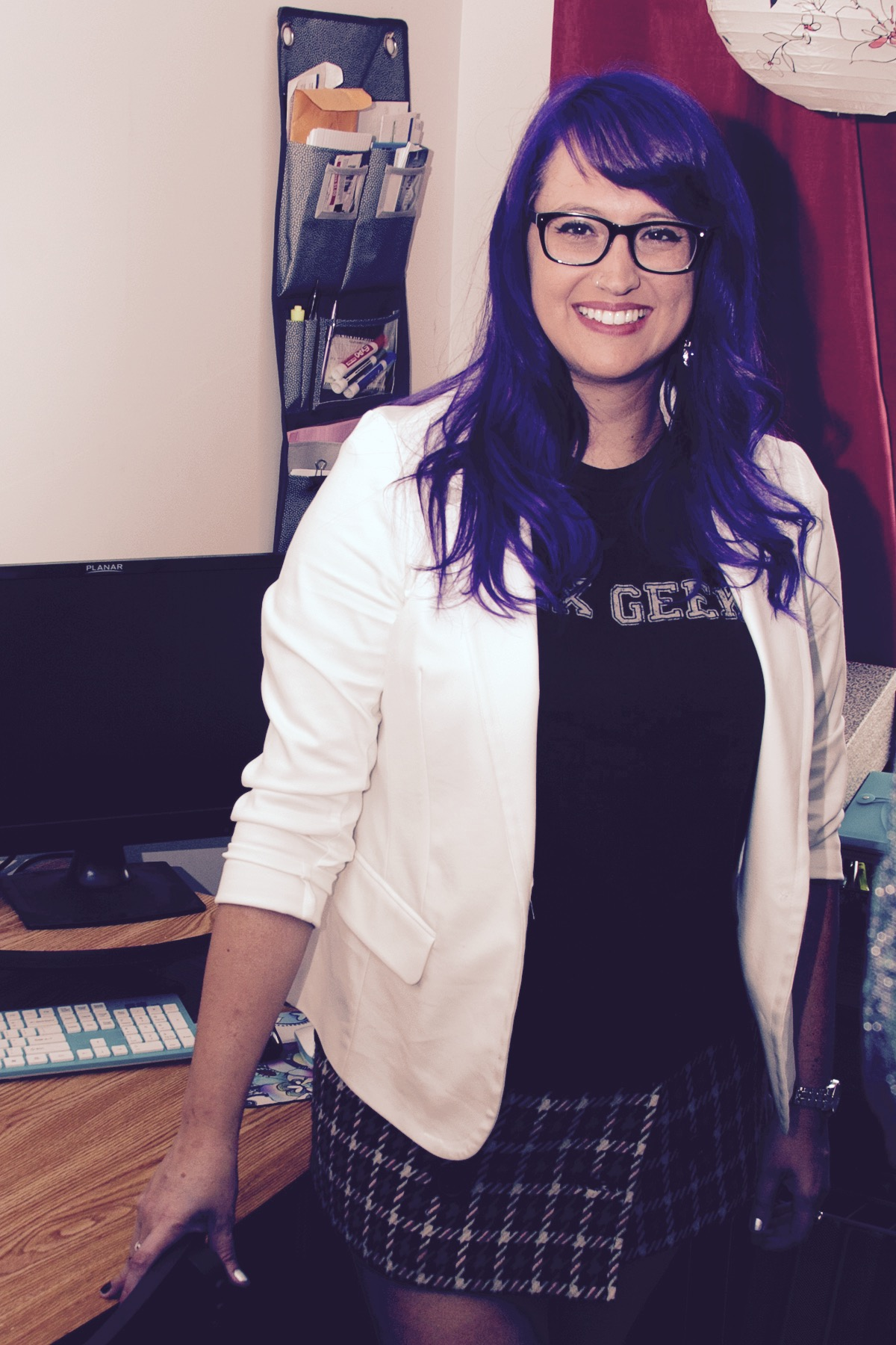 Angel with glasses, purple hair, and a white jacket over a black shirt.