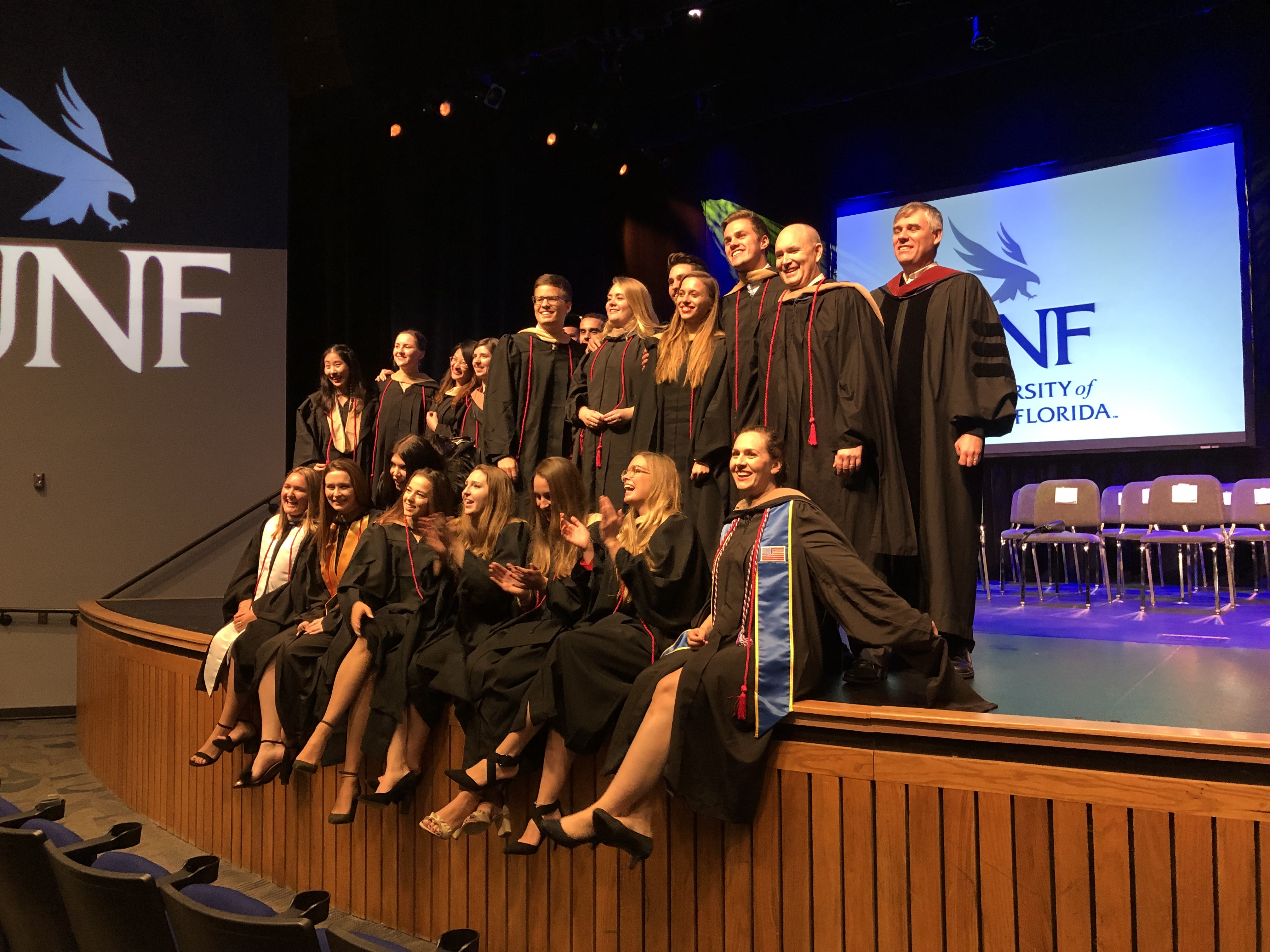 students at graduation on stage