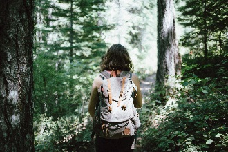 Woman backpacking in the Woods