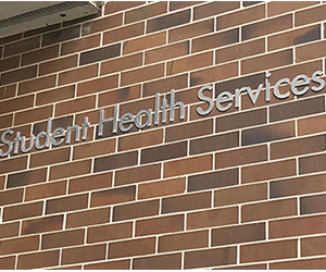Student Health Services sign on brick wall