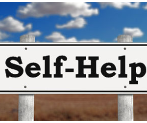 Self Help on a street sign with a blue sky