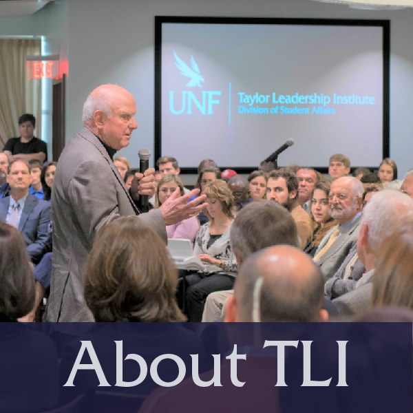 About TLI Button with image of Bruce Taylor speaking to crowd, links to About TLI page