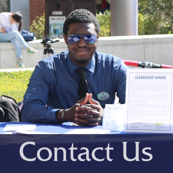 Contact Us button with image of student sitting at Market Days table, links to the Contact Us page
