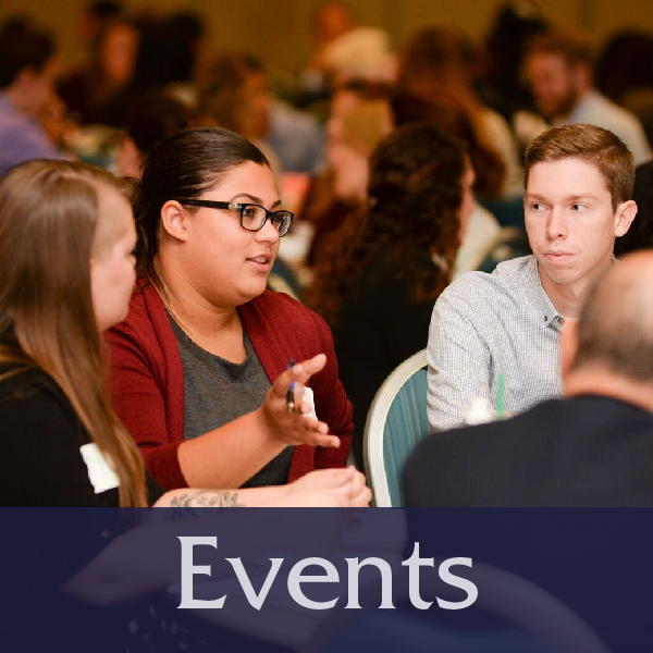 Events button with picture of students talking at Summit event, links to Upcoming Events page