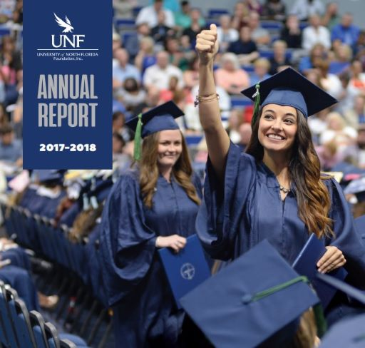 girl giving a thumbs up at graduation -  Annual Report 2017-2018