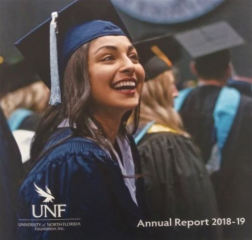 Girl smiling at graduation -  Annual Report 2018-2019