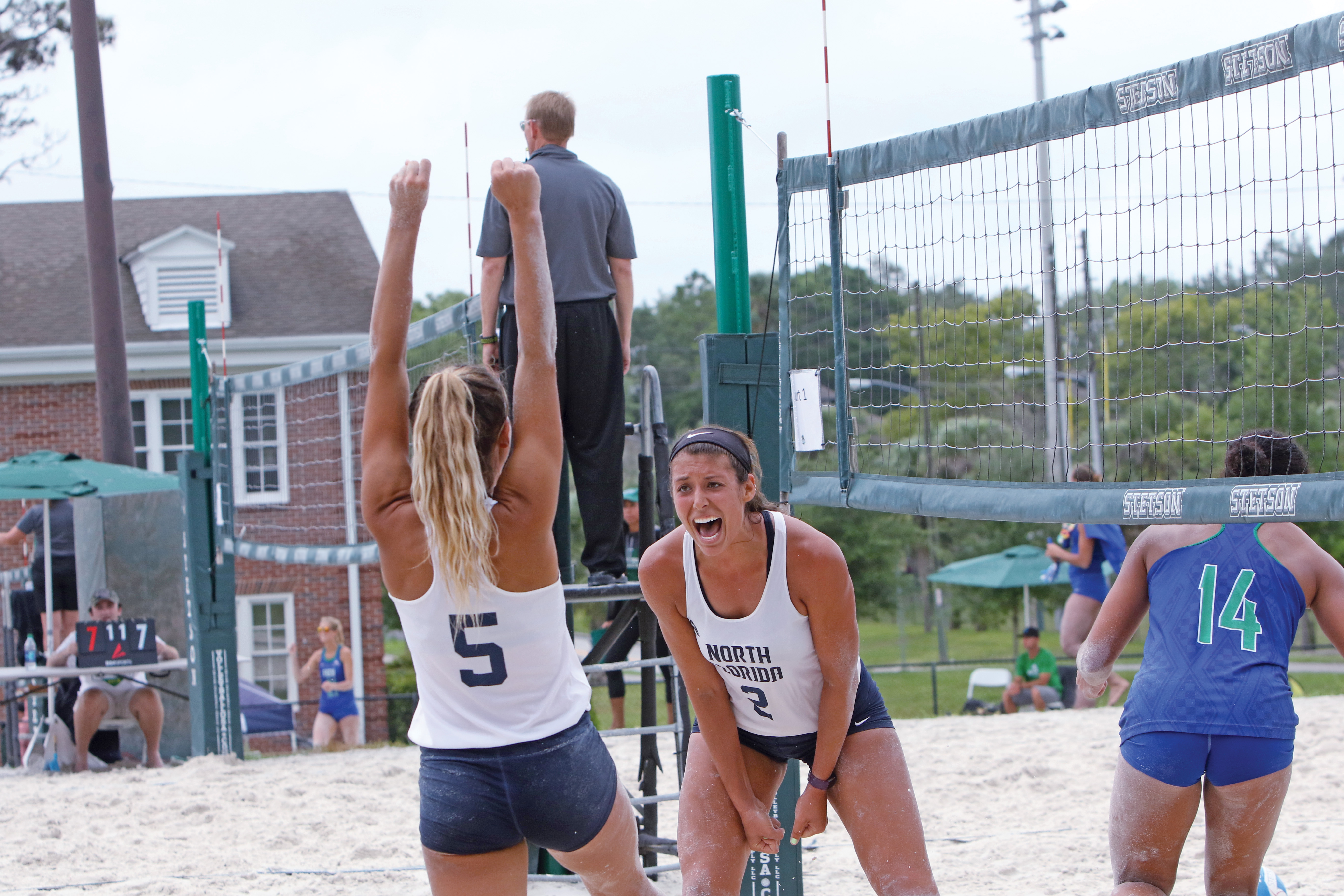 UNF beach volleyball players celebrate a point during a game